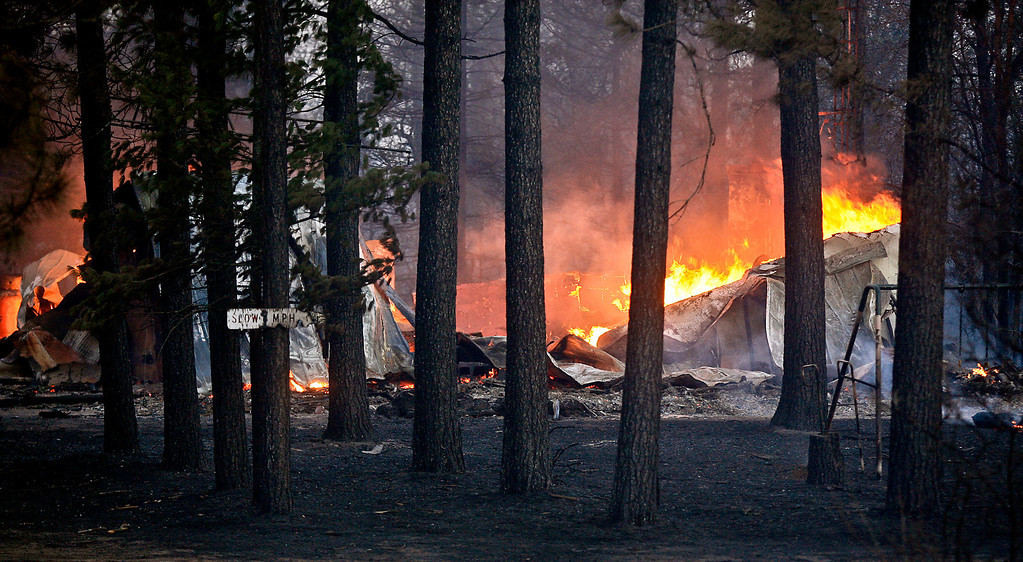 . A structure burns along Sutfin Road east of Comminsky Road in Highland Township, Wis., east of Solon Springs, Wis.,  late Tuesday, May 14, 2013. (AP Photo/The Duluth News-Tribune, Clint Austin)