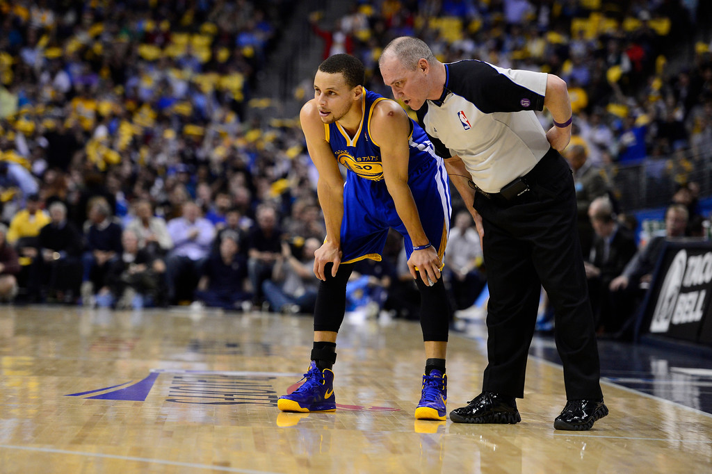 . The referee talks with Golden State Warriors point guard Stephen Curry (30) in the second quarter. The Denver Nuggets took on the Golden State Warriors in Game 5 of the Western Conference First Round Series at the Pepsi Center in Denver, Colo. on April 30, 2013. (Photo by AAron Ontiveroz/The Denver Post)