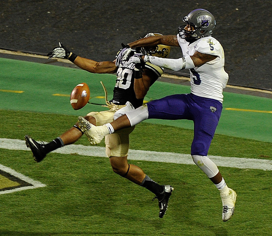 . BOULDER, CO. - SEPTEMBER 76: Buffs defensive back Greg Henderson (20) broke up a pass intended for ACU receiver Dezmin Lewis (5) late in the fourth quarter. The University of Colorado football team defeated Central Arkansas University 38-24 at Folsom Field Saturday night, September 7, 2013. Photo By Karl Gehring/The Denver Post