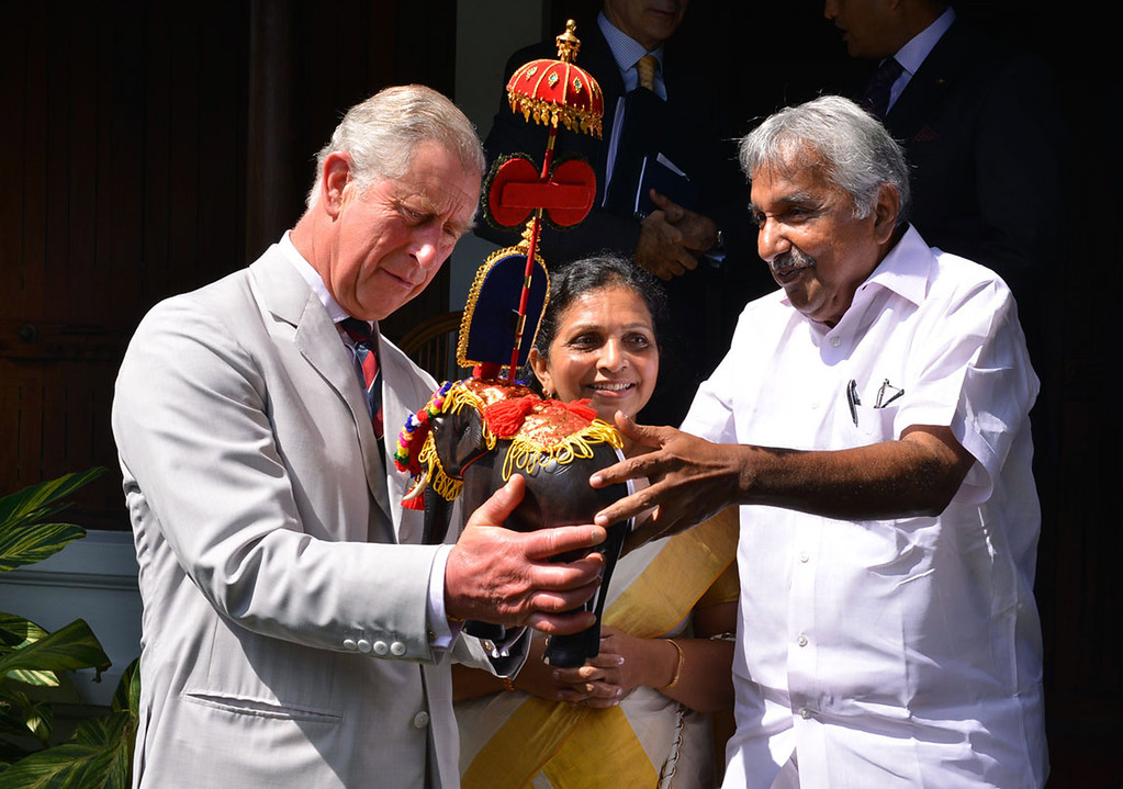 . Chief Minister of the southern Indian state of Kerala Oommen Chandy (R) presents a birthday present to Britain\'s Prince Charles (L) on the occasion of Charles\'s 65th birthday in Kumarakam on November 14, 2013.  AFP PHOTO/STRSTRDEL/AFP/Getty Images