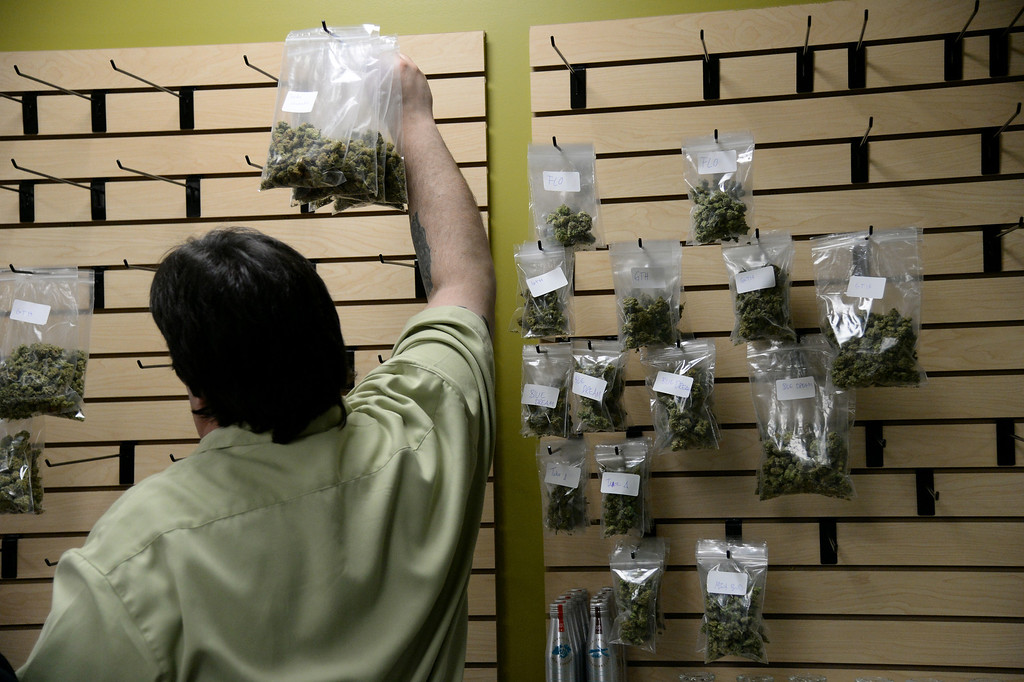 . DENVER, CO. DECEMBER 31: Nelson Figueiredo is prepares bags of marijuana for sale at Medicine Man marijuana dispensary on New Years Eve, December 31, 2013.  (Photo by Hyoung Chang/The Denver Post)