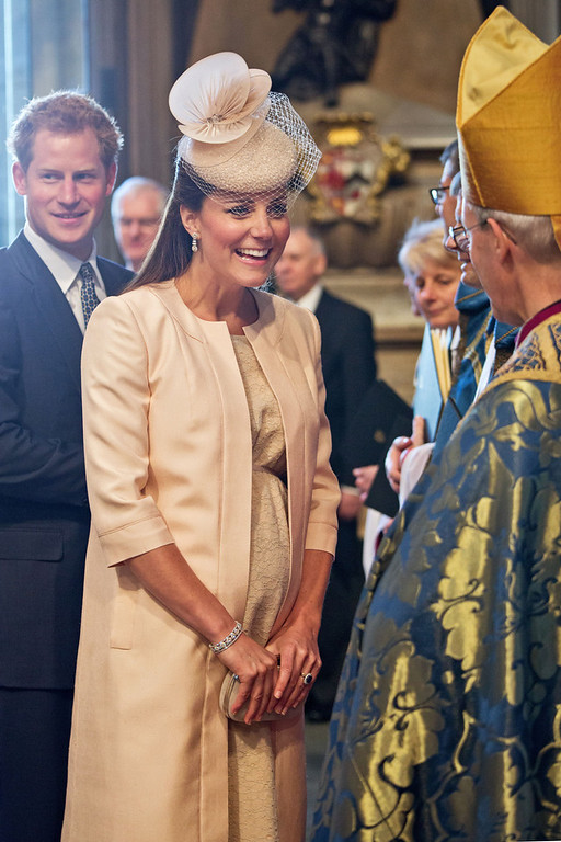 . Catherine, The Duchess of Cambridge (C) speaks with The Archbishop if Canterbury Justin Welby (R) as Prince Harry looks on during a service to Celebrate the 60th Anniversary of the Coronation Service at Westminster Abbey in London on June 4, 2013.  Queen Elizabeth II marked the 60th anniversary of her coronation with a service at Westminster Abbey filled with references to the rainy day in 1953 when she was crowned.  JACK HILL/AFP/Getty Images
