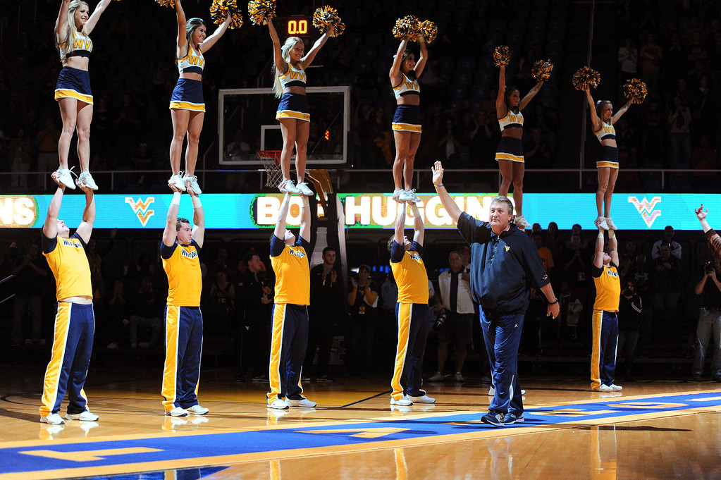 . West Virginia coach Bob Huggins is introduced for the NCAA college basketball team\'s scrimmage, Friday, Oct. 18, 2013, in Morgantown, W.Va. (AP Photo/Andrew Ferguson)