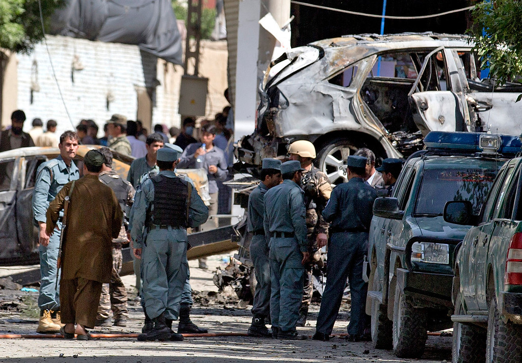 . Afghan and U.S. soldiers arrive to the scene where a suicide car bomber attacked a NATO convoy in Kabul, Afghanistan, Thursday, May 16, 2013. (AP Photo/Anja Niedringhaus)
