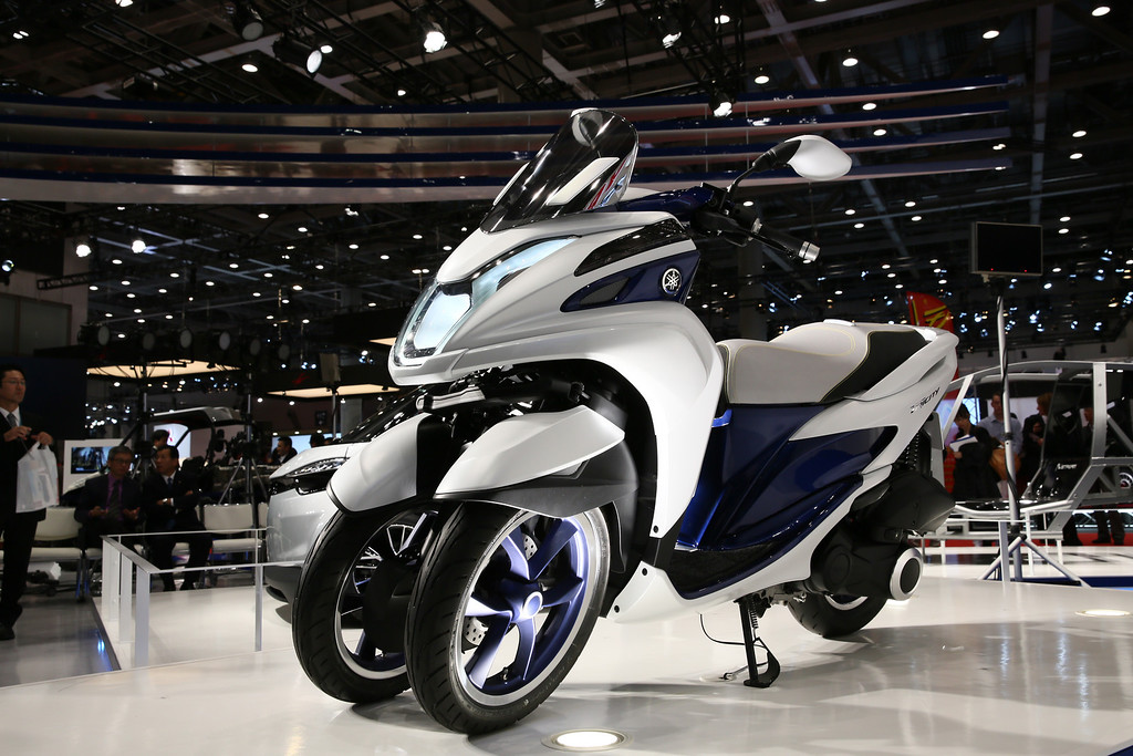 . TRICITY prototype (124 cc) is displayed at the Yamaha booth during the press preview for The 43rd Tokyo Motor Show 2013 at Tokyo Big Sight on November 20, 2013 in Tokyo, Japan.  (Photo by Ken Ishii/Getty Images for YAMAHA)