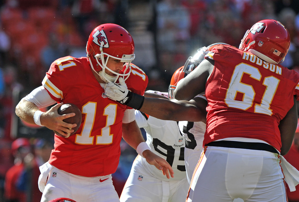 . Linebacker Graig Robertson #53 of the Cleveland Browns reaches in on quarterback Alex Smith #11 of the Kansas City Chiefs during the second half on October 27, 2013 at Arrowhead Stadium in Kansas City, Missouri.  Kansas City won 23-17. (Photo by Peter Aiken/Getty Images)