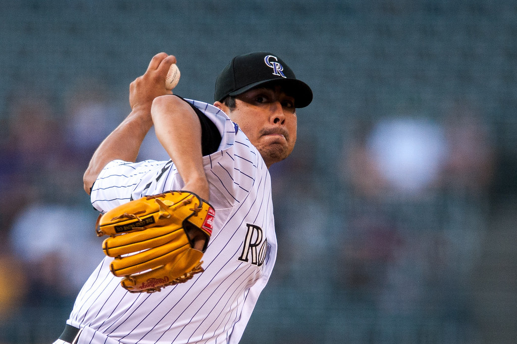 . DENVER, CO - JULY 24:  Jorge De La Rosa #29 of the Colorado Rockies pitches in the first inning of a game against the Miami Marlins at Coors Field on July 24, 2013 in Denver, Colorado. (Photo by Dustin Bradford/Getty Images)