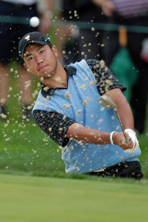 . International team player Hideki Matsuyama, of Japan, hits out of a bunker on the first hole during the single matches at the Presidents Cup golf tournament at Muirfield Village Golf Club Sunday, Oct. 6, 2013, in Dublin, Ohio. (AP Photo/Jay LaPrete)