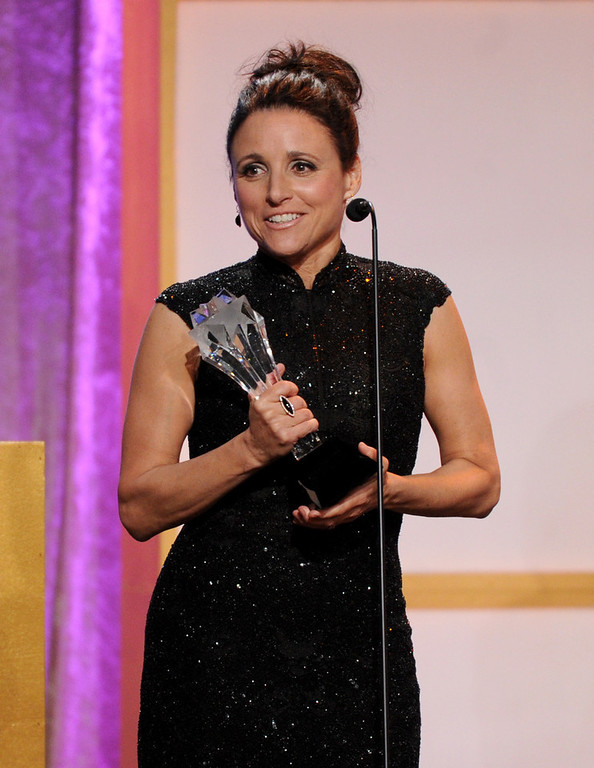 ". Julia Louis-Dreyfus accepts award for best actress in a comedy series for ""Veep\"" at the Critics\' Choice Television Awards in the Beverly Hilton Hotel on Monday, June 10, 2013, in Beverly Hills, Calif. (Photo by Frank Micelotta/Invision/AP)"