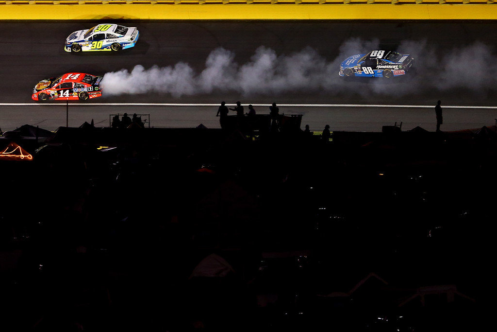 . CONCORD, NC - OCTOBER 12:  Smoke pours from the #14 Bass Pro Shops / Mobil 1 Chevrolet, driven by Mark Martin during the NASCAR Sprint Cup Series Bank of America 500 at Charlotte Motor Speedway on October 12, 2013 in Concord, North Carolina.  (Photo by Streeter Lecka/Getty Images)