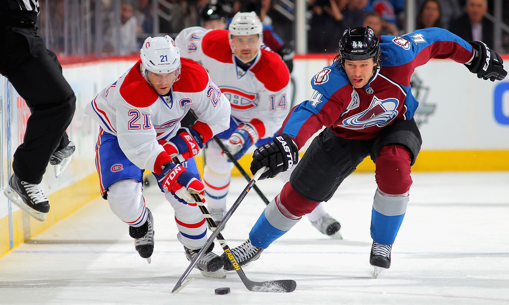 . DENVER, CO - NOVEMBER 02:  Brian Gionta #21 of the Montreal Canadiens controls the puck against Ryan Wilson #44 of the Colorado Avalanche at Pepsi Center on November 2, 2013 in Denver, Colorado.  (Photo by Doug Pensinger/Getty Images)