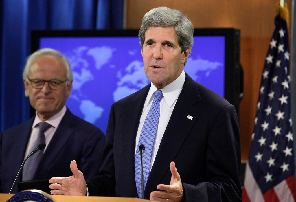 """. U.S. Secretary of State John Kerry (R) speaks next to Martin Indyk at the State Department in Washington July 29, 2013. Kerry named former U.S. ambassador to Israel Indyk as his main envoy in Israeli-Palestinian talks starting in Washington later on Monday seeking \""""reasonable compromises\"""" in the tough negotiations.  REUTERS/Yuri Gripas"""