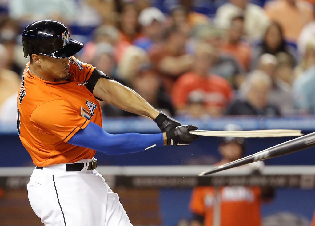 . Miami Marlins\' Giancarlo Stanton breaks his bat while batting during the fourth inning of an opening day baseball game against the Colorado Rockies, Monday, March 31, 2014, in Miami. (AP Photo/Lynne Sladky)