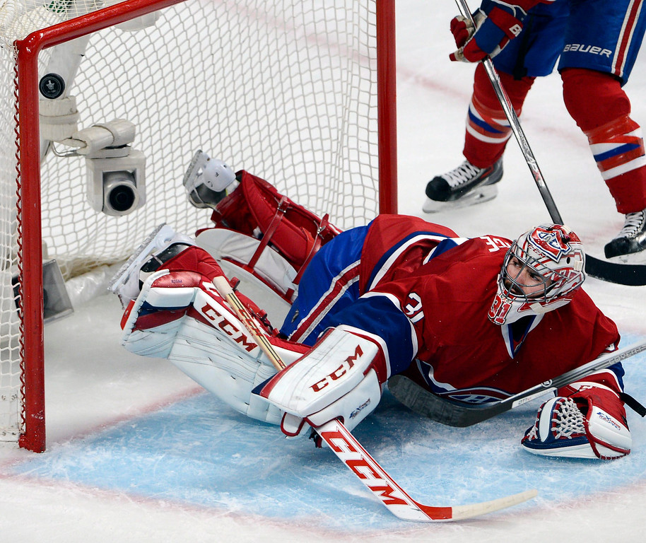 . Montreal Canadiens goalie Carey Price (31) lets in the fourth goal against the New York Rangers during the second period in Game 1 of the Eastern Conference finals in the NHL hockey Stanley Cup playoffs against in Montreal on Saturday, May 17, 2014. (AP Photo/The Canadian Press, Adrian Wyld)