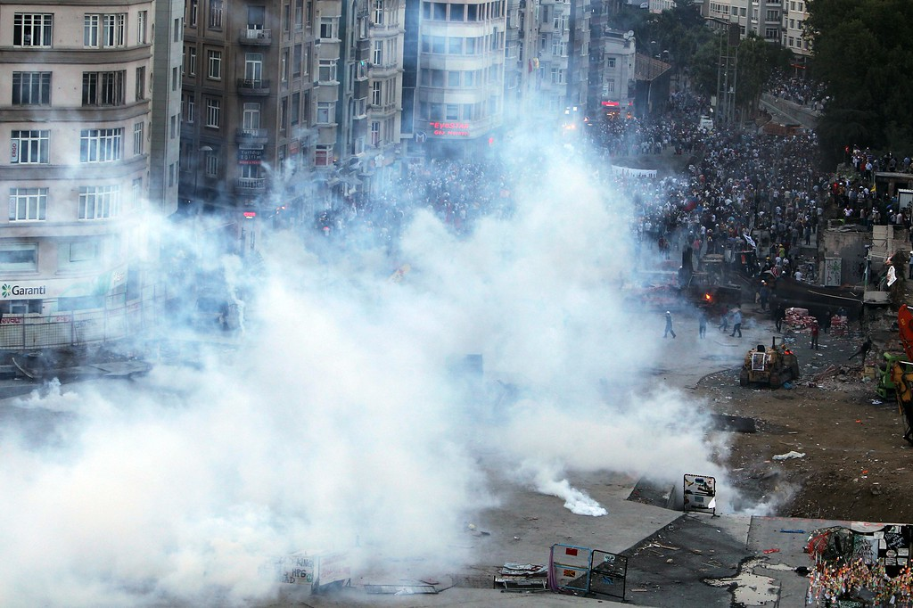 . Police throw tear gas at protesters during clashes at the Taksim Square in Istanbul Tuesday, June 11, 2013.  (AP Photo/Thanassis Stavrakis)