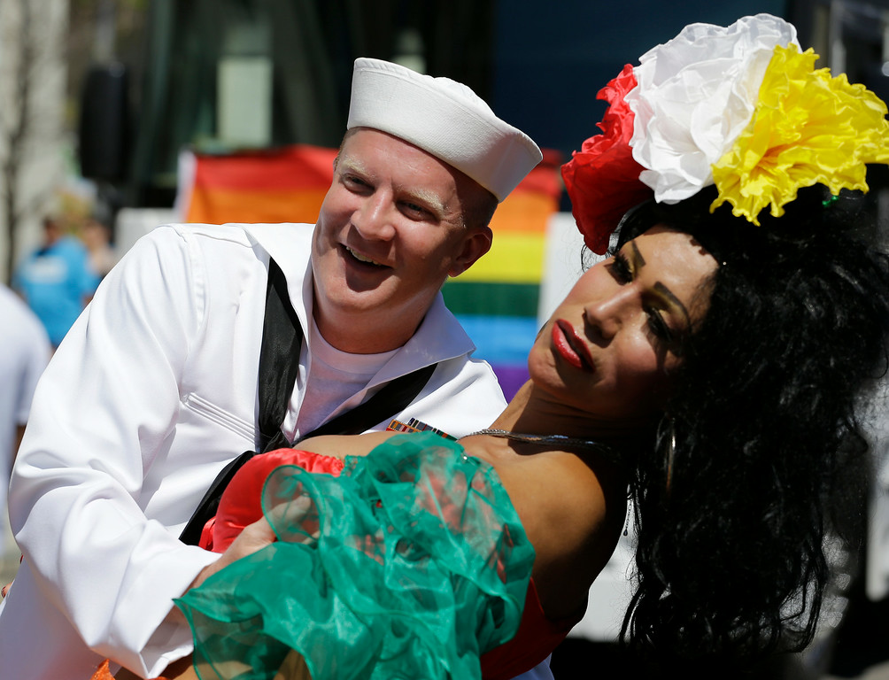. Lee Reinhart, left, dances with Bianca Dorres at the 45th Annual Chicago Pride Parade on Broadway in Chicago, Sunday, June 29, 2014. The event, the first since Illinois\' law allowing same-sex marriage went into effect, has 200 registered entrants, with about 1 million expected to participate. (AP Photo/Nam Y. Huh)