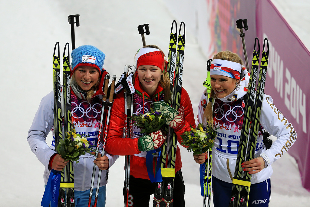 . (L-R) Bronze medalist Tiril Eckhoff of Norway, gold medalist Darya Domracheva of Belarus and silver medalist Gabriela Soukalova of the Czech Republic celebrate during the flower ceremony for the Women\'s 12.5 km Mass Start during day ten of the Sochi 2014 Winter Olympics at Laura Cross-country Ski & Biathlon Center on February 17, 2014 in Sochi, Russia.  (Photo by Richard Heathcote/Getty Images)