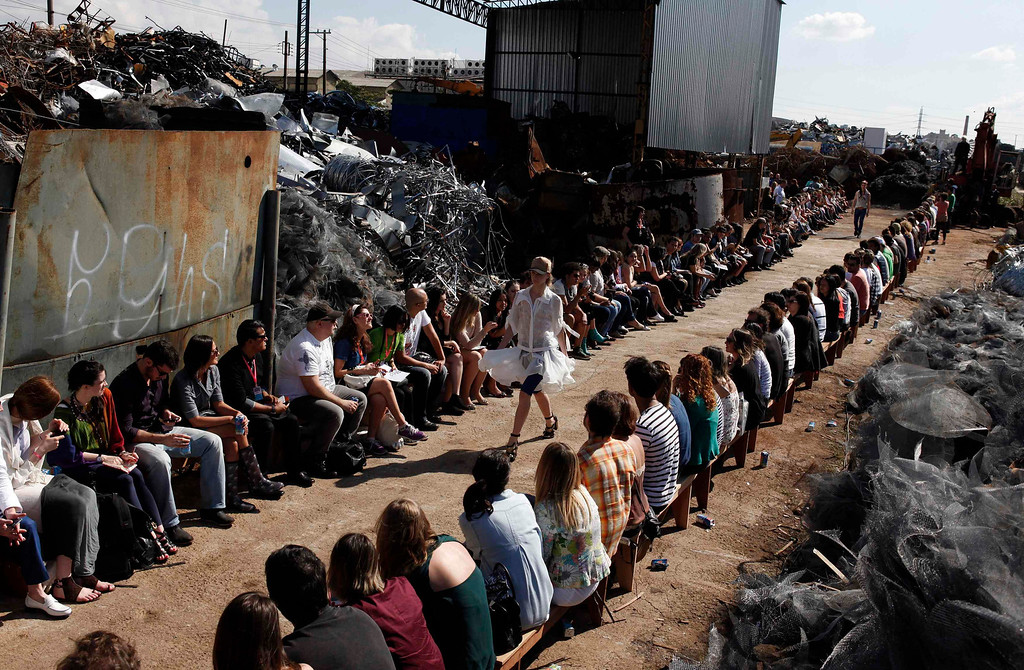 . A model presents a creation from the Cavalera Summer 2012/2013 collection at a junkyard, during Sao Paulo Fashion Week June 16, 2012.  REUTERS/Nacho Doce