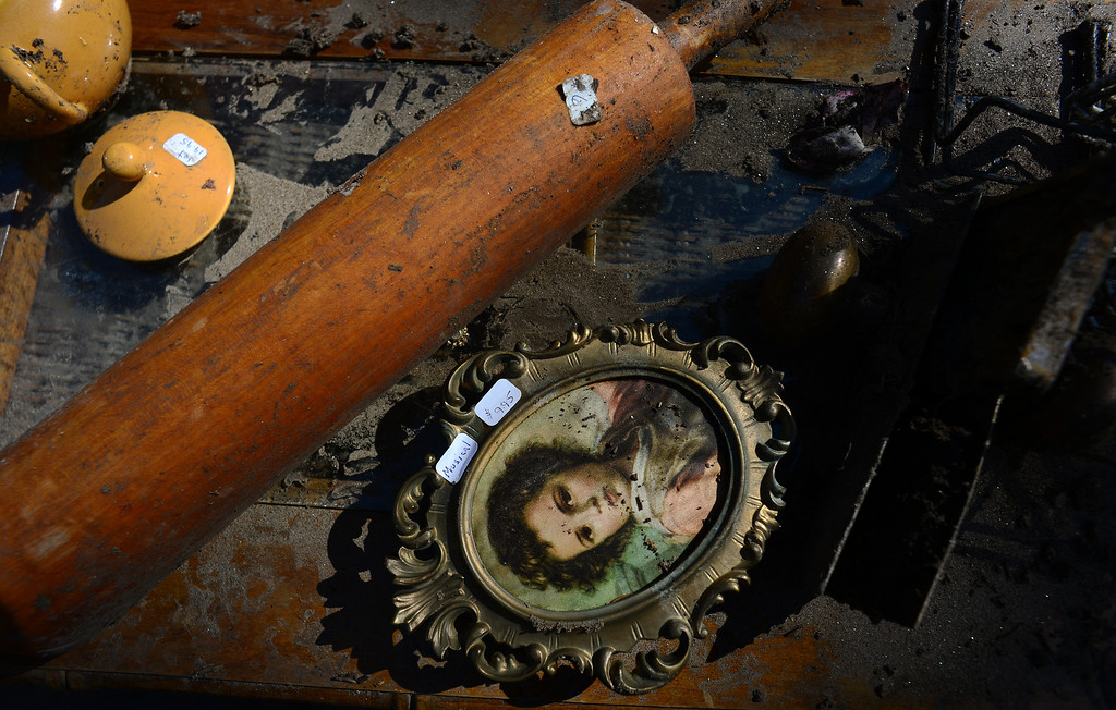 . GLEN HAVEN, CO - OCTOBER 8: These are some of the antique collectibles that survived the flood that came from inside the historic Glen Haven Inn in Glen Haven, CO on October 8, 2013.  The Inn was one of the only businesses that actually made it in the town but has been inundated with mud and debris.  (Photo By Helen H. Richardson/ The Denver Post)