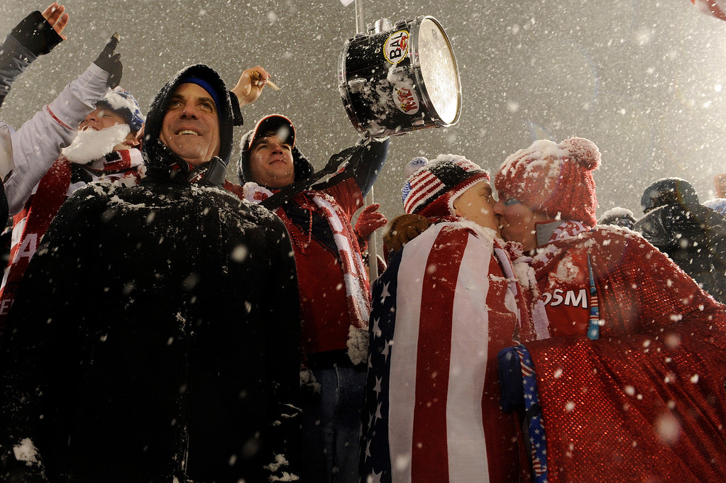 . COMMERCE CITY, CO - MARCH 22: Doug Jotzke, center right, kisses his wife, Tanya Keith, far right, after the United States men\'s national team defeated Costa Rica 1-0 during a FIFA 2014 World Cup Qualifier game at Dick\'s Sporting Goods Park on March 22, 2013, in Commerce City, Colorado. (Photo by Daniel Petty/The Denver Post)