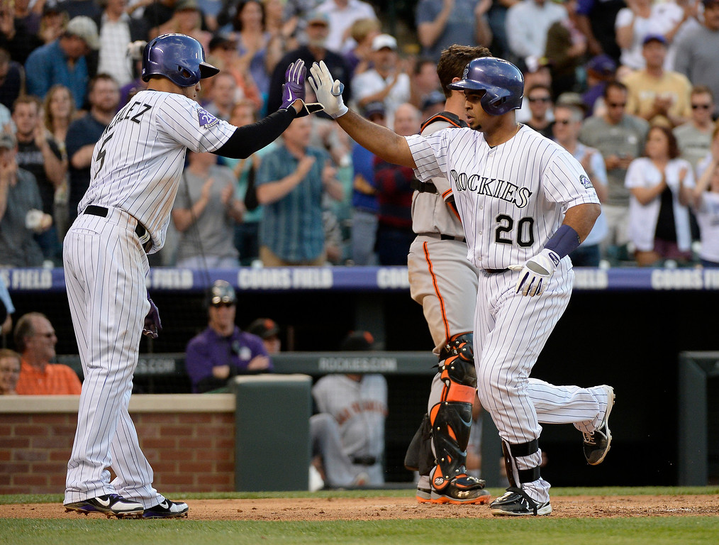 . Carlos Gonzalez (5) of the Colorado Rockies high fives Wilin Rosario (20) of the Colorado Rockies after he hit a three run home run during the third inning off of Matt Cain (18) of the San Francisco Giants  May 16, 2013 at Coors Field. (Photo By John Leyba/The Denver Post)