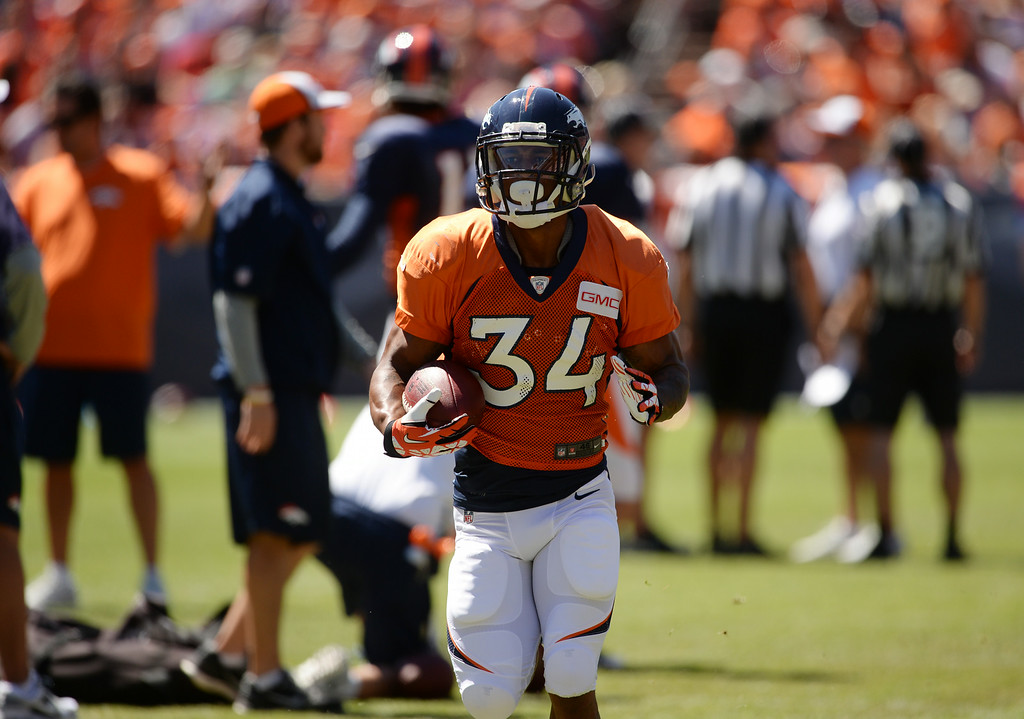 . Brennan Clay of Denver Broncos (34) is warming up for the Broncos scrimmage at Sports Authority Field at Mile High. Denver, Colorado. August 02. 2014. (Photo by Hyoung Chang/The Denver Post)