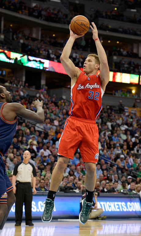 . Los Angeles Clippers forward Blake Griffin (32) takes a shot during the third quarter against the Denver Nuggets March 17, 2014 at Pepsi Center. (Photo by John Leyba/The Denver Post)