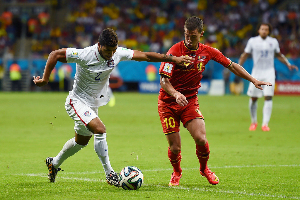 . DeAndre Yedlin of the United States controls the ball against Eden Hazard of Belgium during the 2014 FIFA World Cup Brazil Round of 16 match between Belgium and the United States at Arena Fonte Nova on July 1, 2014 in Salvador, Brazil.  (Photo by Laurence Griffiths/Getty Images)
