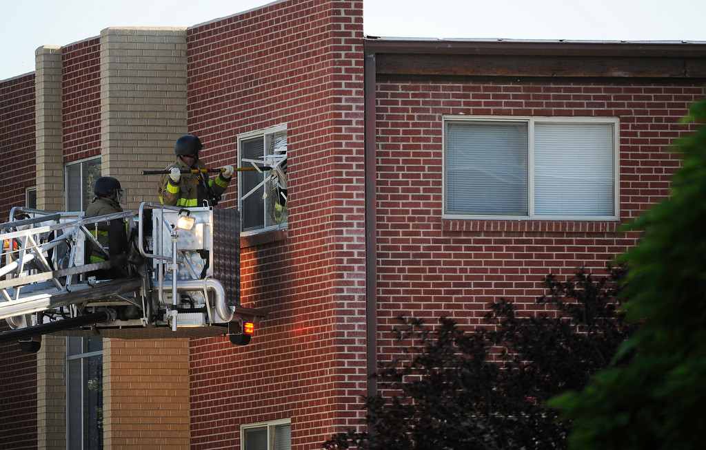 . Law enforcement officials broke in the windows as they searched the home of Aurora Mall Theater shooting suspect James Holmes at Paris and 17th Ave. on Friday, July 20, 2012. They entered from the outside with the help of a fire truck ladder. Cyrus McCrimmon, The  Denver Post