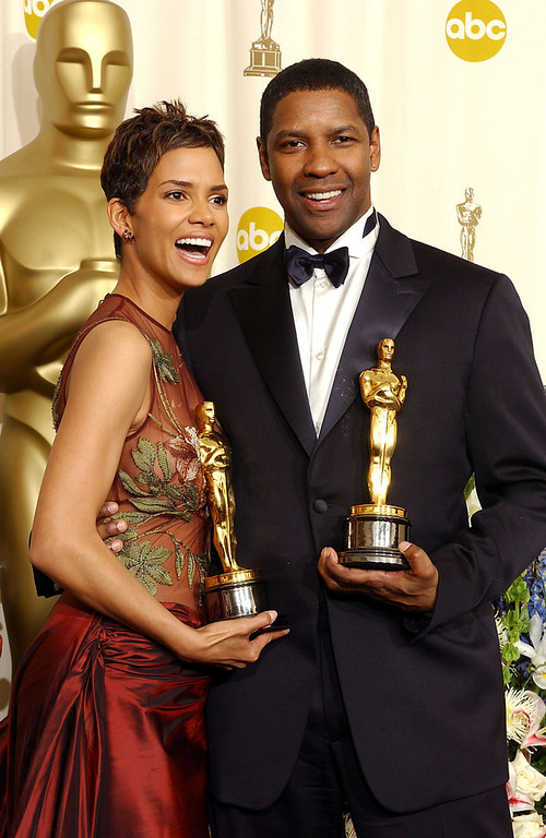 . Best Actress winner Halle Berry and Best Actor winner Denzel Washington holds their Oscar statuetes backstage at the 74th Annual Academy Awards held at the Kodak Theatre in Hollywood, Ca., March 24, 2002. (Photo by Frank Micelotta/GettyImages)