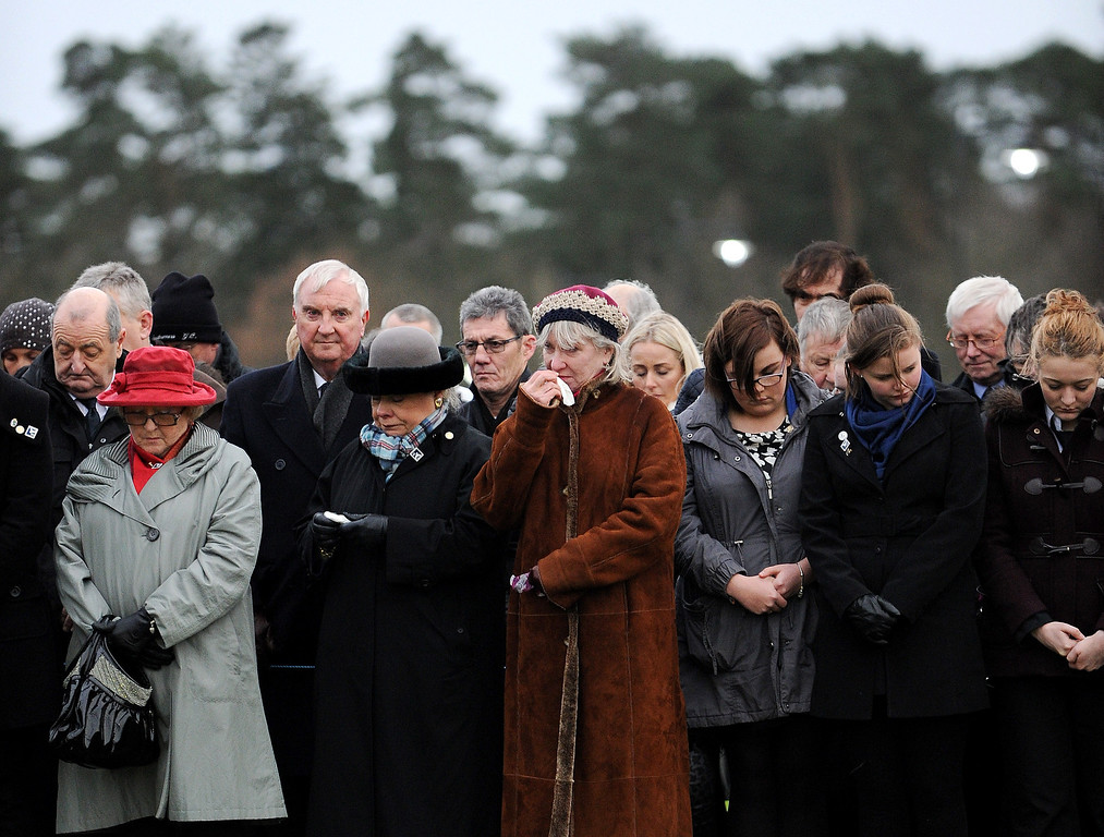 . Families, relatives and dignitaries gather to pay their respects at the memorial service in Dryfesdale cemetery to commemorate the 25th anniversary of the air disaster on December 21, 2013 in Lockerbie, Scotland.  (Photo by Ian Forsyth/Getty Images)