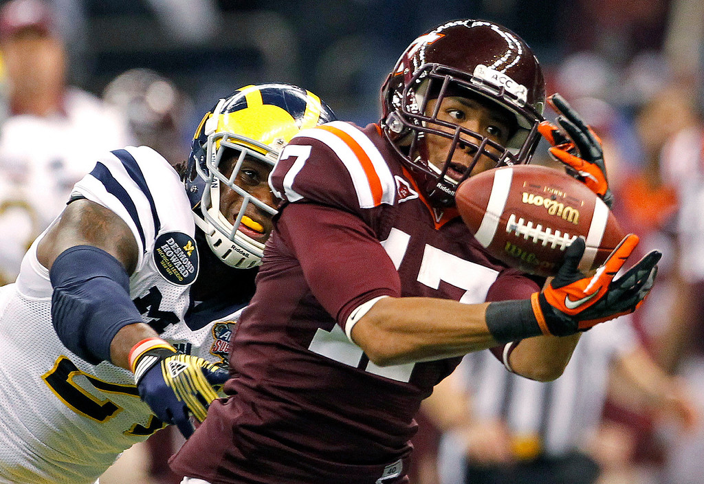 . Virginia Tech cornerback Kyle Fuller (17) intercepts a pass intended for Michigan wide receiver Junior Hemingway (21) during the first quarter of the Sugar Bowl NCAA college football game in New Orleans, Tuesday, Jan. 3, 2012. Fuller was picked #14 overall by the Chicago Bears in the 2014 NFL draft.  (AP Photo/Dave Martin)