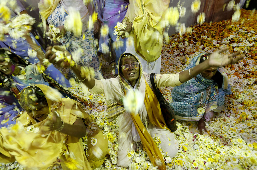 . An Indian widow throws petals while participating in the Holi festival in Vrindavan, Uttar Pradesh, India, March 14, 2014.  EPA/HARISH TYAGI