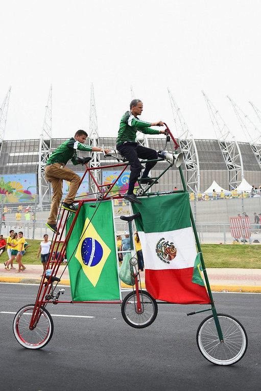 . FORTALEZA, BRAZIL - JUNE 17:  Fans ride a custom tricycle decorated with flags of Mexico and Brazil prior to the 2014 FIFA World Cup Brazil Group A match between Brazil and Mexico at Castelao on June 17, 2014 in Fortaleza, Brazil.  (Photo by Laurence Griffiths/Getty Images)