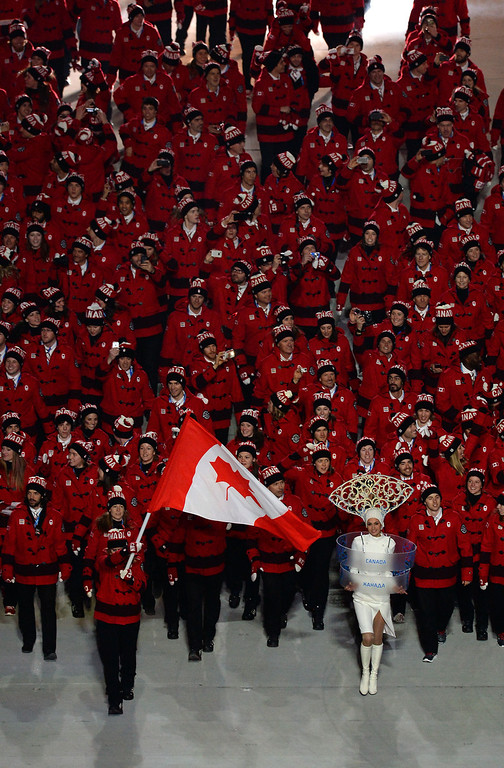 . Belgium\'s flag bearer, bobsledder Hanna Emilie Marien leads her national delegation during the Opening Ceremony of the Sochi Winter Olympics at the Fisht Olympic Stadium on February 7, 2014 in Sochi.     AFP PHOTO / YURI KADOBNOV/AFP/Getty Images