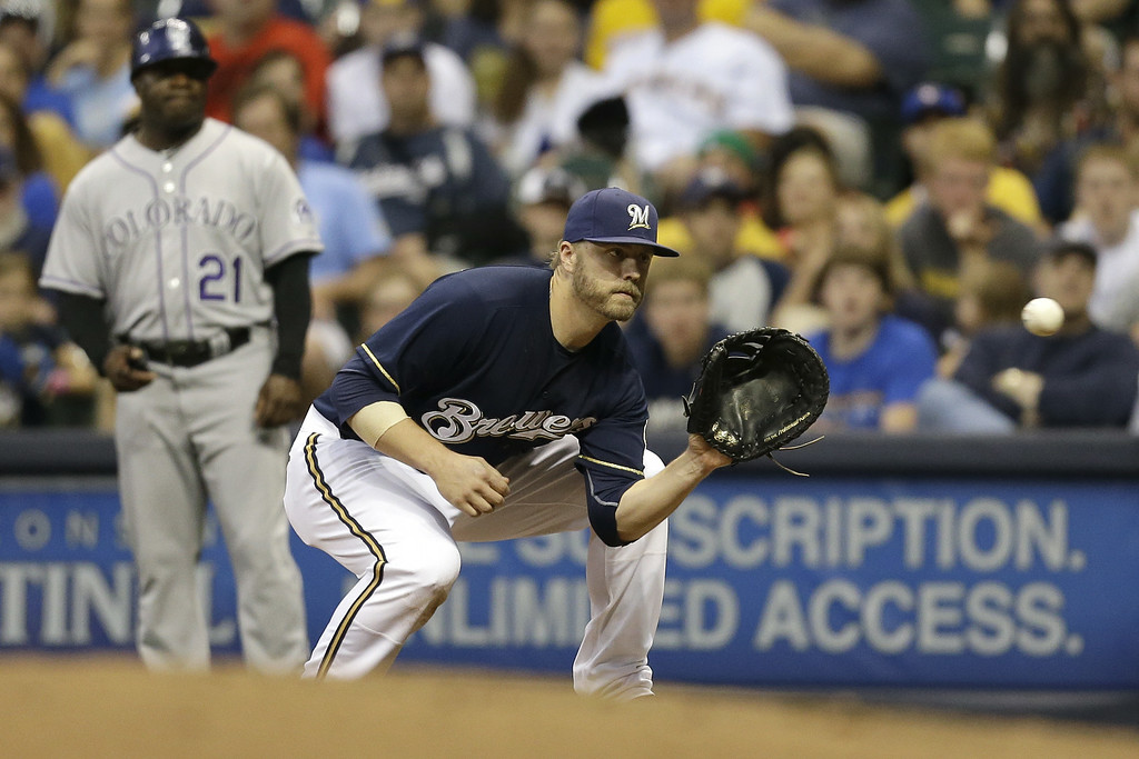 . MILWAUKEE, WI - JUNE 27: Mark Reynolds #7 of the Milwaukee Brewers makes the grab at first base to retire Drew Stubbs of the Colorado Rockies during the top of the sixth inning at Miller Park on June 27, 2014 in Milwaukee, Wisconsin. (Photo by Mike McGinnis/Getty Images)