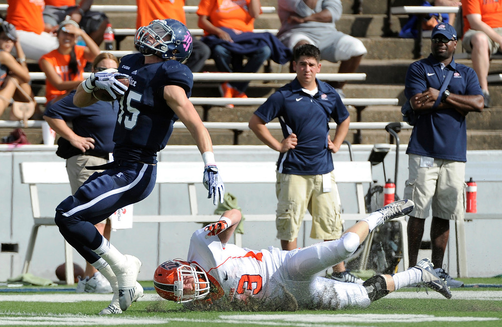 . Rice wide receiver Jordan Taylor (15) breaks away from UTEP\'s Wesley Miller (13) for a touchdown during the first half of an NCAA college football game Saturday, Oct. 26, 2013, in Houston. (APPhoto/Pat Sullivan)