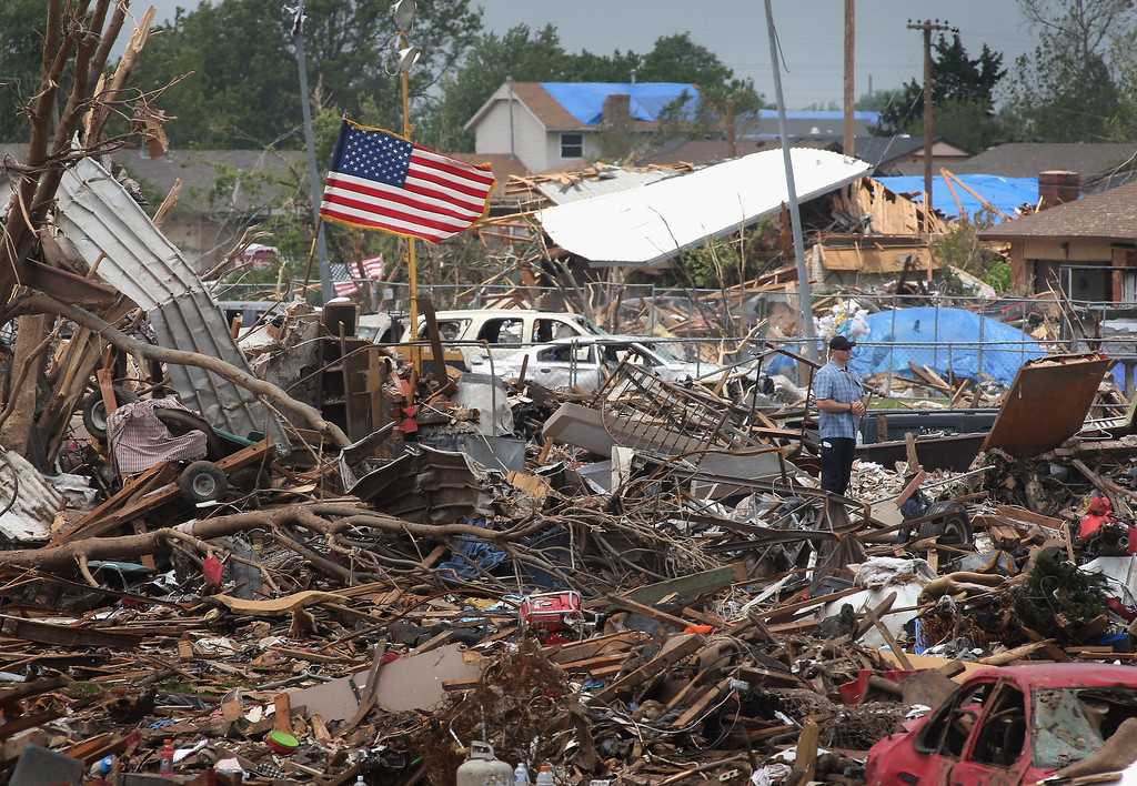 . A member of the president\'s security detail stands guard during a visit by U.S. President Barack Obama to the tornado-damaged area May 26, 2013 in Moore, Oklahoma. President Obama toured Plaza Towers Elementary School where 7 children were killed by the May 20 tornado during his visit to Moore.  (Photo by Scott Olson/Getty Images)