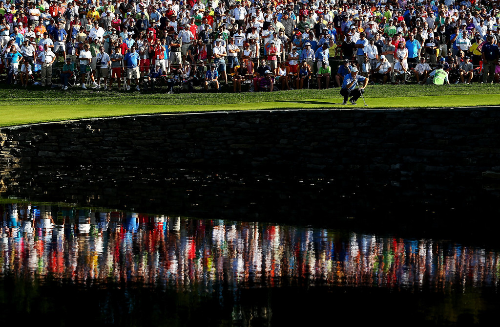 . Jim Furyk of the United States lines up a putt on the 15th green during the final round of the 95th PGA Championship on August 11, 2013 in Rochester, New York.  (Photo by Streeter Lecka/Getty Images)