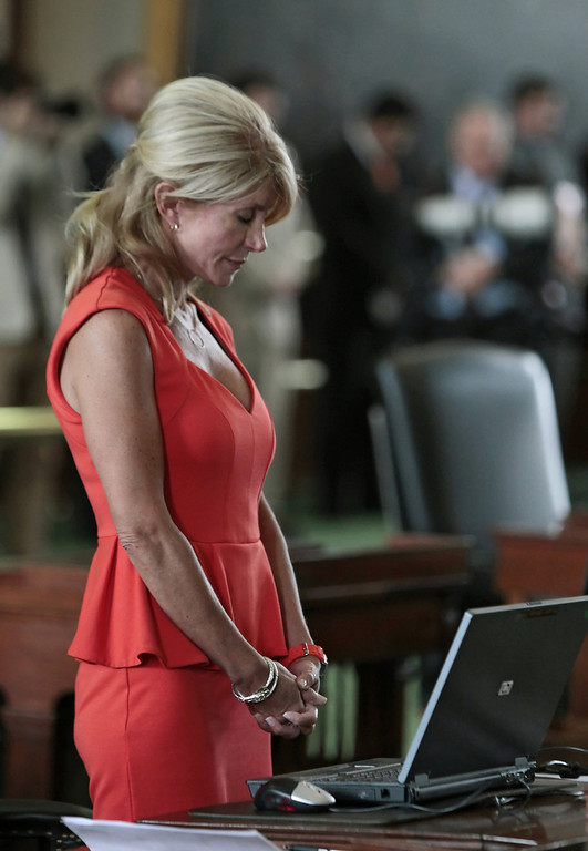 . Texas Sen. Wendy Davis (D-Ft. Worth) bows her head in prayer on the first day of the second legislative special session on July 1, 2013 in Austin, Texas. This is the first day of a second legislative special session called by Texas Gov. Rick Perry to pass a restrictive abortion law through the Texas legislature. The first attempt was defeated after opponents of the law were able to stall the vote until after first special session had ended.  (Photo by Erich Schlegel/Getty Images)