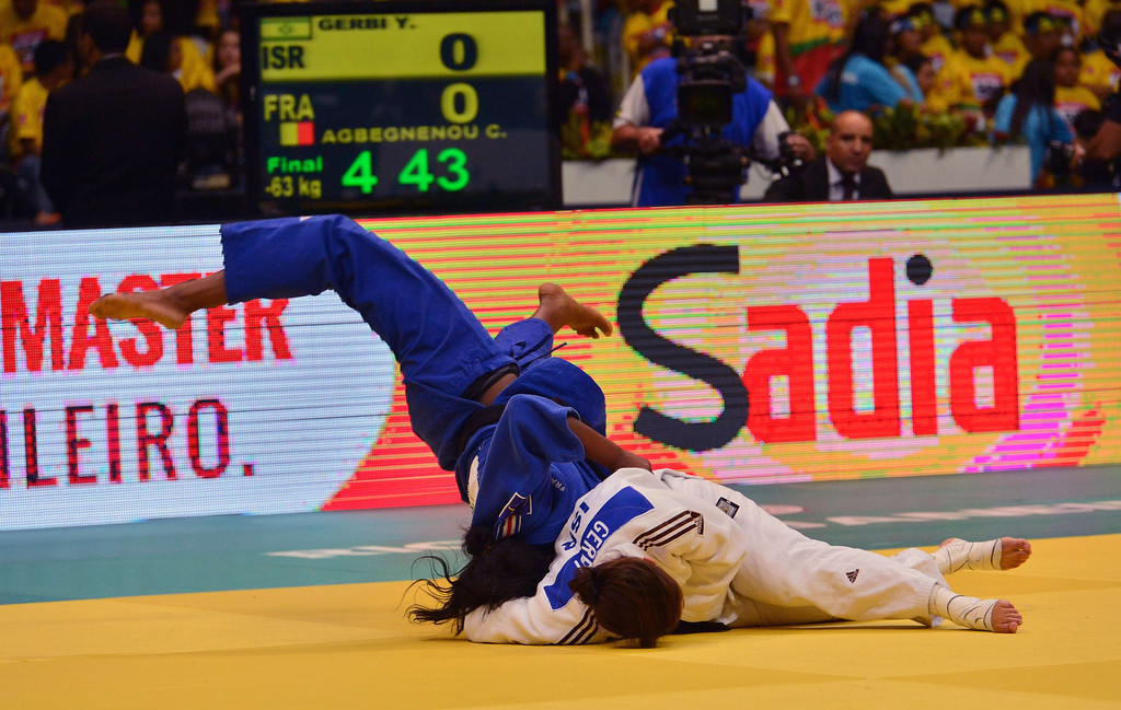 . Israel\'s Yarden Gerbi (R) and France\'s Clarisse Agbegnenou compete in the women\'s -63kg category final, during the IJF World Judo Championship, in Rio de Janeiro, Brazil, on August 29, 2013.  YASUYOSHI CHIBA/AFP/Getty Images
