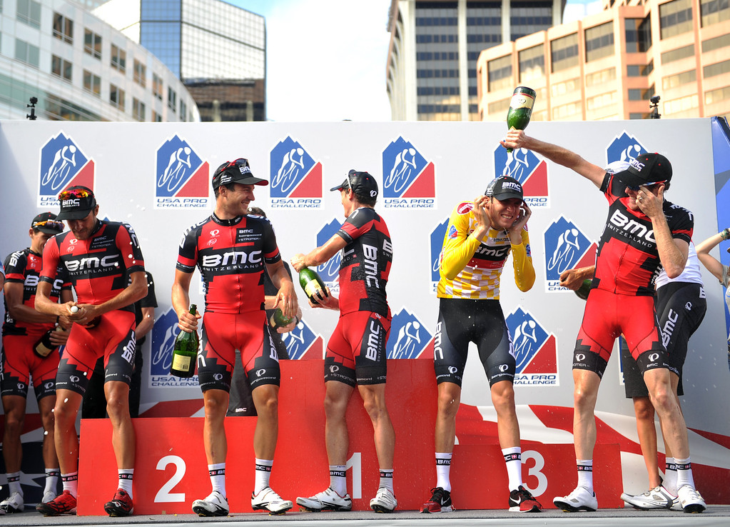 . The BMC racing team and Tejay Van Garderen, 2nd from right, celebrate winning the 2013 USA Pro Challenge race as a team in Denver, Colorado on August 25, 2013. (Photo by Hyoung Chang/The Denver Post)