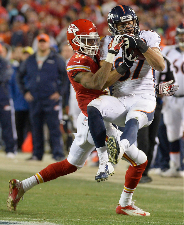 . Denver Broncos wide receiver Eric Decker (87) catches a pass on Kansas City Chiefs cornerback Marcus Cooper (31) during the fourth quarter December 1, 2013 at Arrowhead Stadium. Eric Decker ended the day with 8 REC, 174 YDS, 4 TD.  (Photo by John Leyba/The Denver Post)
