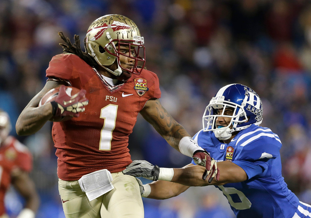 . In this Dec. 7 2013, file photo, Florida State\'s Kelvin Benjamin (1) runs past Duke\'s Ross Cockrell (6) for a touchdown in the second half of the Atlantic Coast Conference Championship NCAA football game in Charlotte, N.C. Benjamin was selected in the first round, 28th overall, by the Carolina Panthers in the NFL draft on Thursday, May 8, 2014. (AP Photo/Bob Leverone, File)