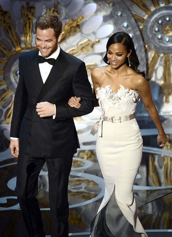 . Actor Chris Pine and actress Zoe Saldana present onstage during the Oscars held at the Dolby Theatre on February 24, 2013 in Hollywood, California.  (Photo by Kevin Winter/Getty Images)