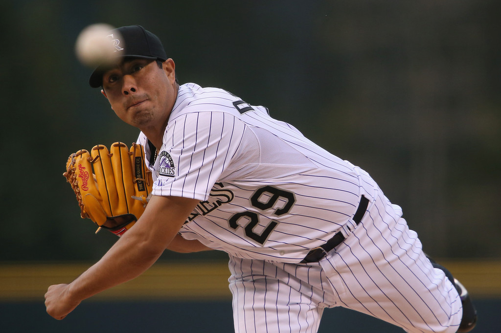 . DENVER, CO - MAY 02:  Starting pitcher Jorge De La Rosa #29 of the Colorado Rockies delivers against the New York Mets at Coors Field on May 2, 2014 in Denver, Colorado.  (Photo by Doug Pensinger/Getty Images)