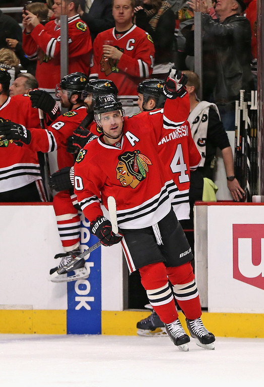 . CHICAGO, IL - DECEMBER 27: Patrick Sharp #10 of the Chicago Blackhawks celebrates the first of his two goals in the first period against the Colorado Avalanche at the United Center on December 27, 2013 in Chicago, Illinois.   (Photo by Jonathan Daniel/Getty Images)
