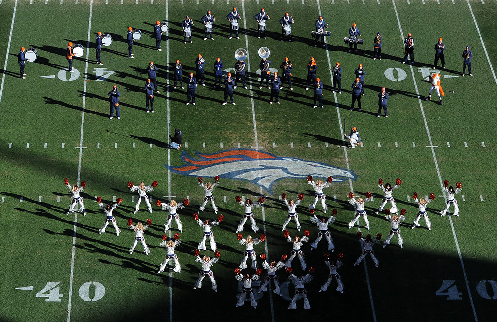 . The band and the Broncos cheerleaders put on a show before the start of the game. The Denver Broncos take on the San Diego Chargers at Sports Authority Field at Mile High in Denver on January 12, 2014. (Photo by Craig F. Walker/The Denver Post)