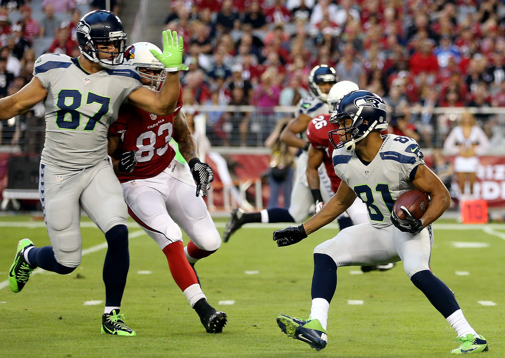 . Wide receiver Golden Tate #81 of the Seattle Seahawks returns a punt against the Arizona Cardinals during a game at the University of Phoenix Stadium on October 17, 2013 in Glendale, Arizona.  (Photo by Christian Petersen/Getty Images)