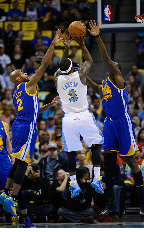 . Denver Nuggets point guard Ty Lawson (3) shoots over Golden State Warriors point guard Jarrett Jack (2) and Golden State Warriors center Festus Ezeli (31) in the second quarter. The Denver Nuggets took on the Golden State Warriors in Game 5 of the Western Conference First Round Series at the Pepsi Center in Denver, Colo. on April 30, 2013. (Photo by AAron Ontiveroz/The Denver Post)